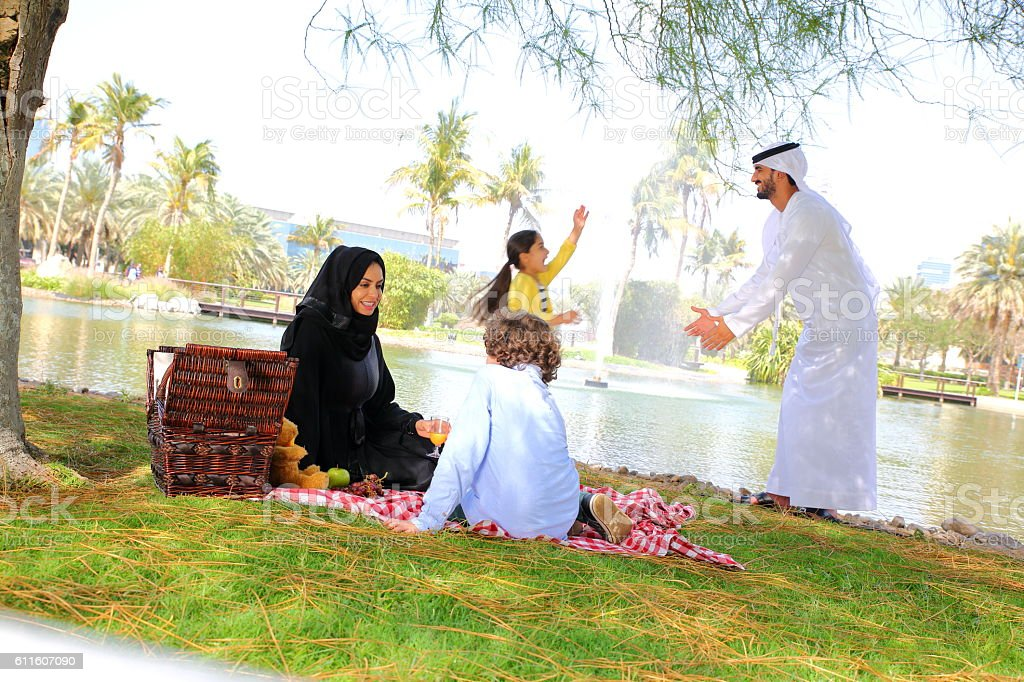 Happy Arab family on picnic outdoors stock photo