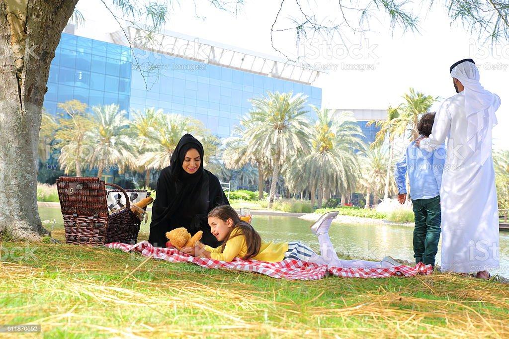 Happy Arab family on picnic outdoors stock photo