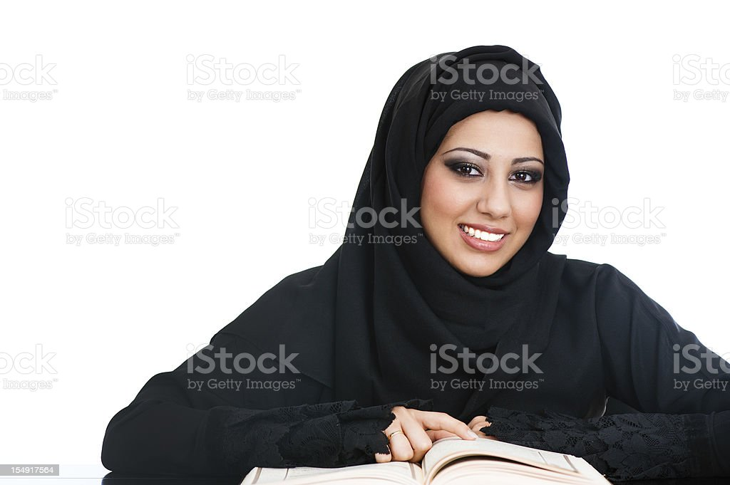 Happy Arabic girl reading the holy Koran royalty-free stock photo