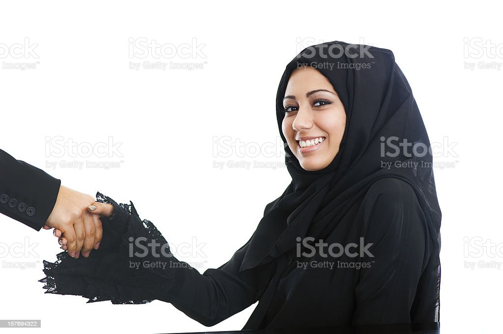 Happy Arabic girl shaking hands royalty-free stock photo