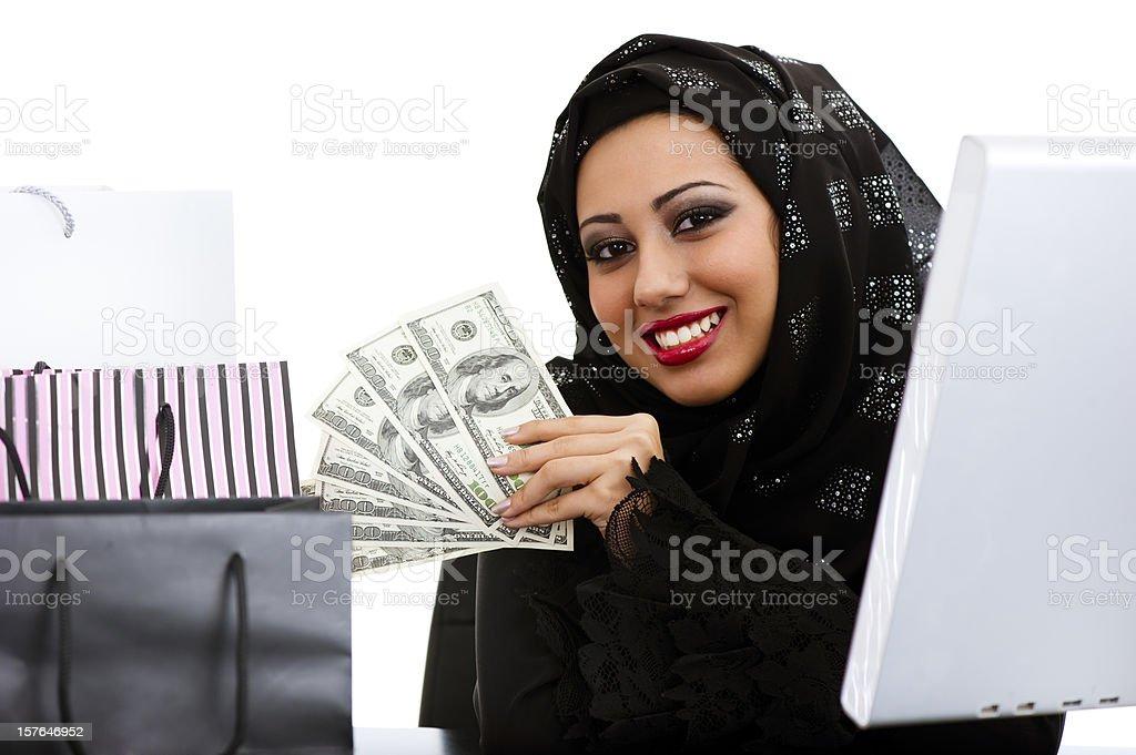 Happy Arabic girl shopping on the internet royalty-free stock photo
