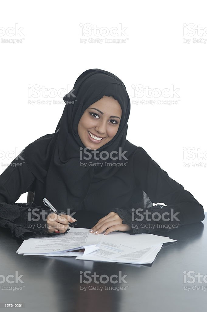 Happy Arabic girl signing papers royalty-free stock photo