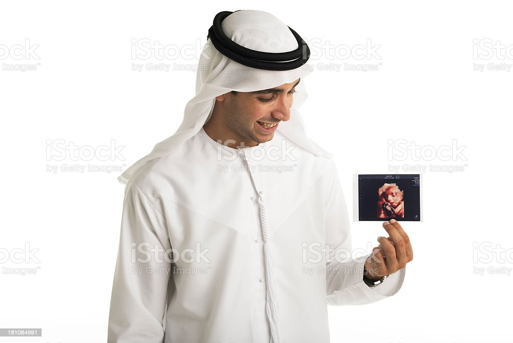 Happy Arabic man holding baby pic royalty-free stock photo