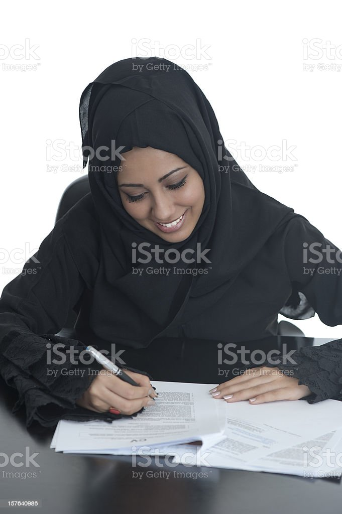 Happy Arabic office girl signs papers royalty-free stock photo