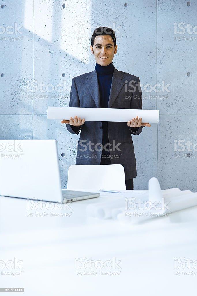 Happy architect holding blueprints royalty-free stock photo