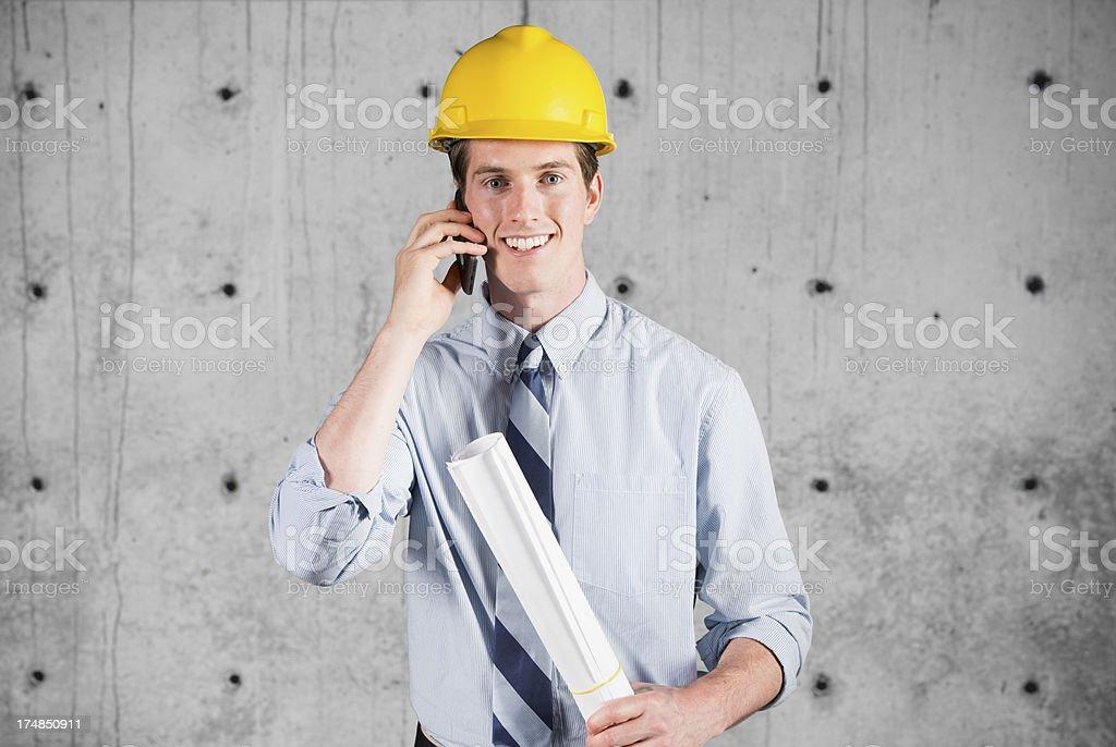 Happy architect talking on mobile phone royalty-free stock photo