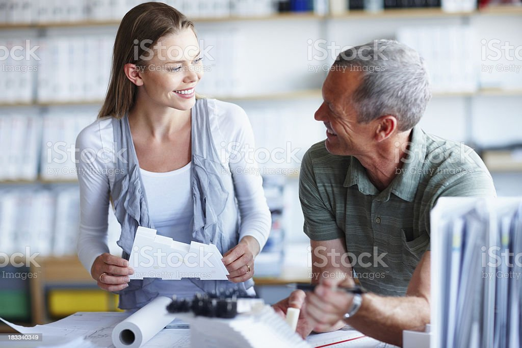 Happy architects working on a project in office royalty-free stock photo