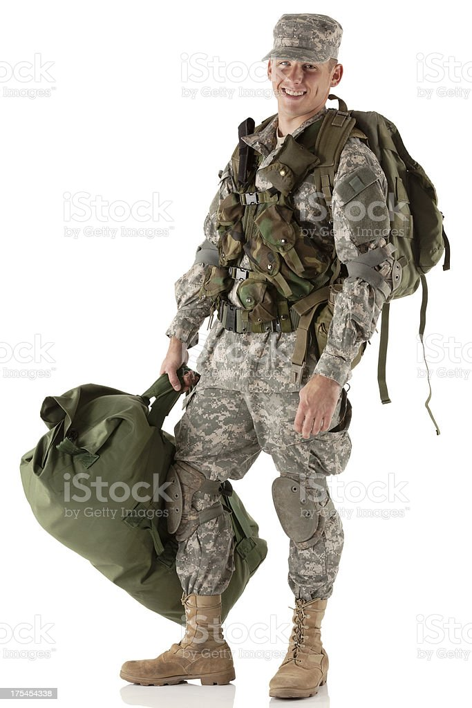 Happy army man carrying his luggage royalty-free stock photo