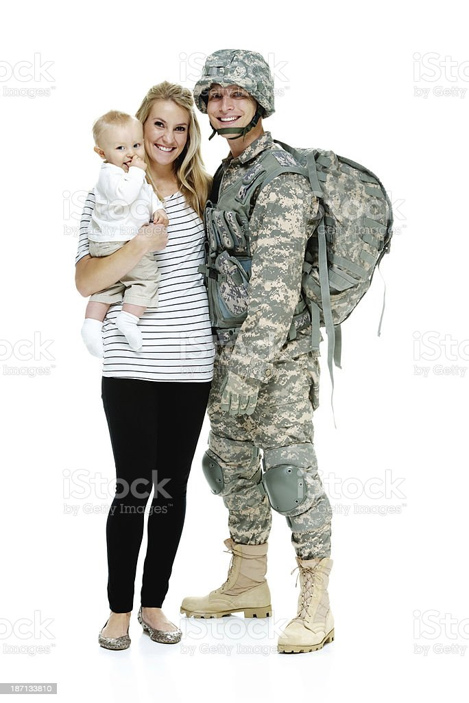 Happy army soldier posing with his family royalty-free stock photo