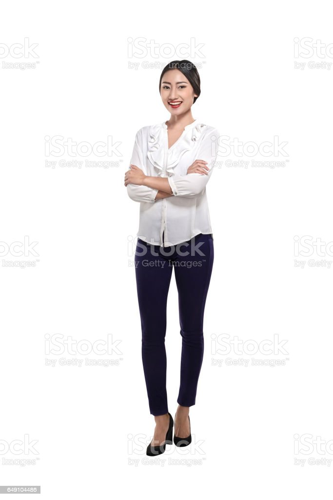Happy asian business woman standing with folded hands stock photo