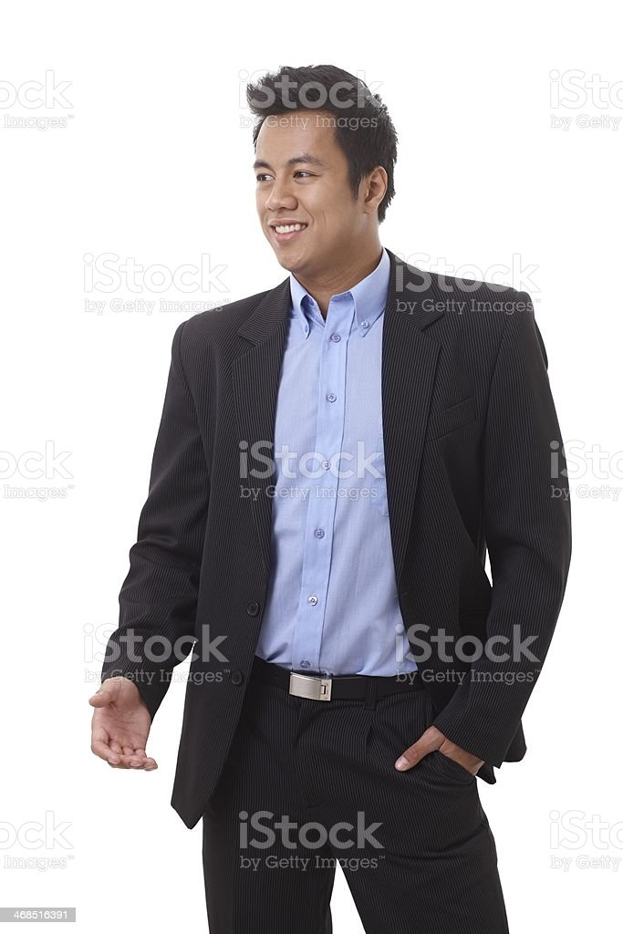 Happy Asian businessman gesturing stock photo