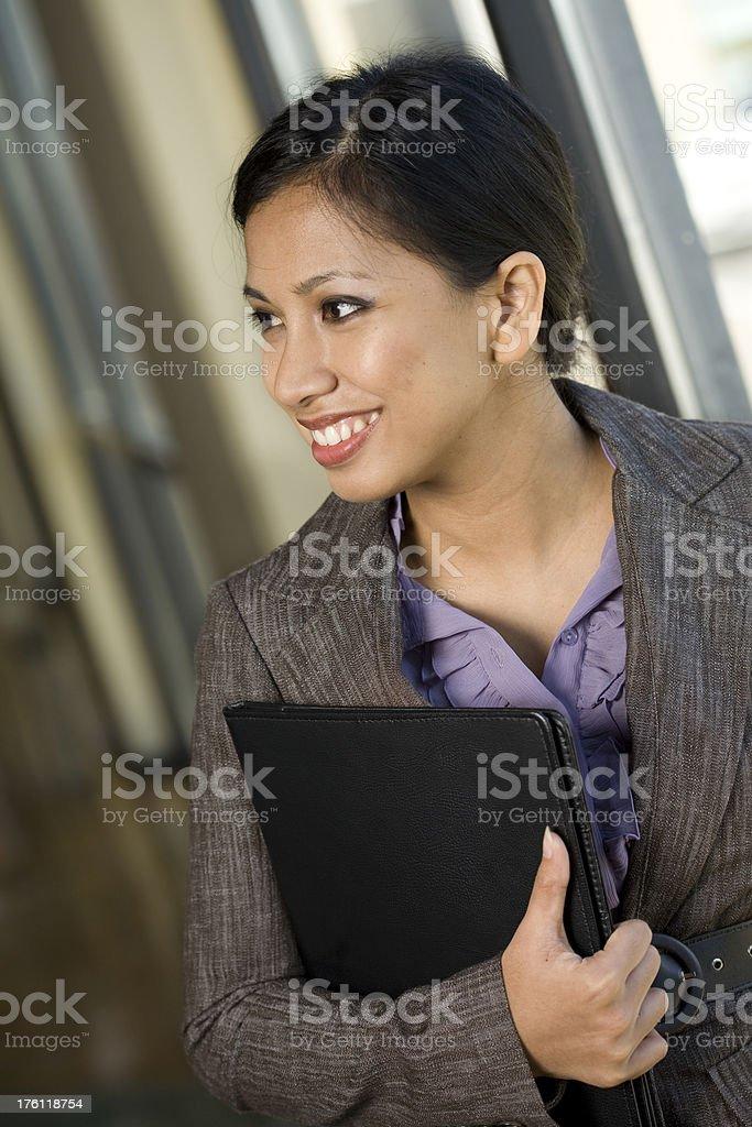 Happy Asian Businesswoman Holding Work Binder royalty-free stock photo