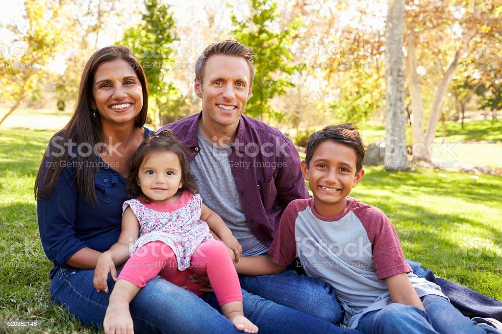 Happy Asian Caucasian mixed race family, portrait in a park stock photo