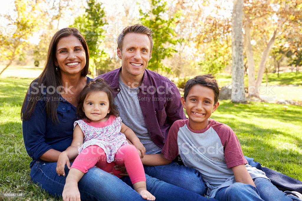 Happy Asian Caucasian mixed race family, portrait in a park stock photo