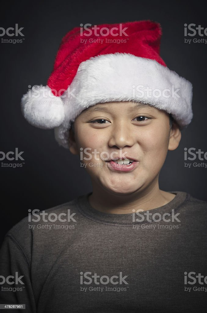 Happy Asian Child for Christmas Wearing A Santa Hat royalty-free stock photo