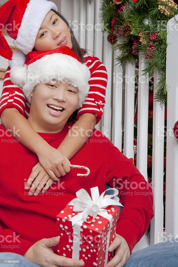 Happy asian couple christmas portrait on staircase royalty-free stock photo