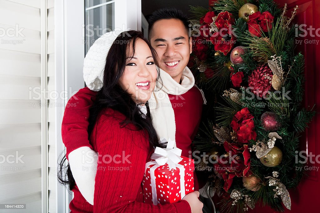 Happy Asian couple outdoor christmas portrait royalty-free stock photo