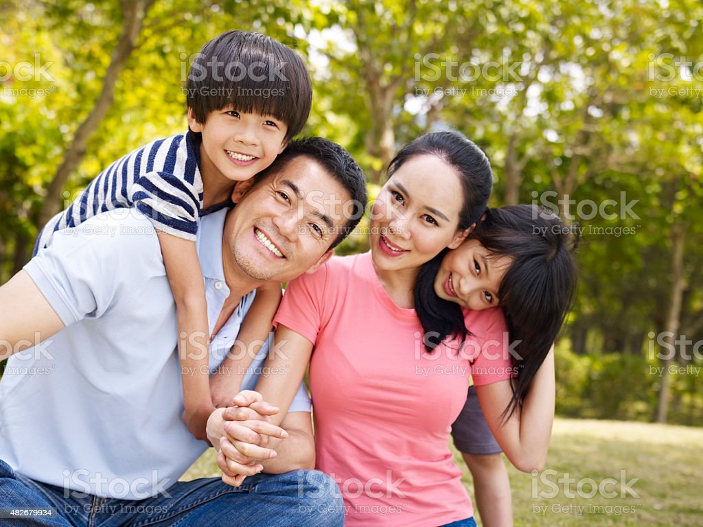 happy asian family in park stock photo