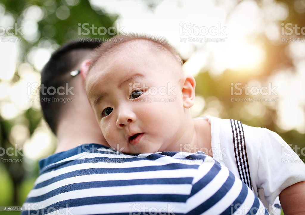 Happy Asian father and son stock photo