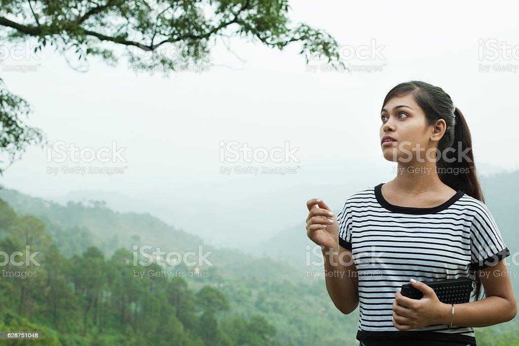 Happy Asian girl enjoying nature in mountains. stock photo