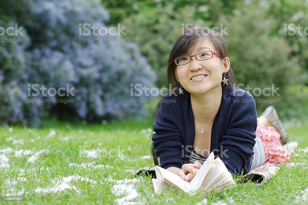 Happy asian girl on a grass royalty-free stock photo