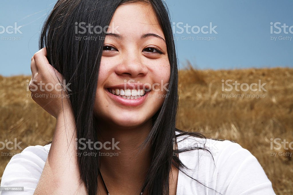 Happy Asian Girl Playing with her Hair royalty-free stock photo