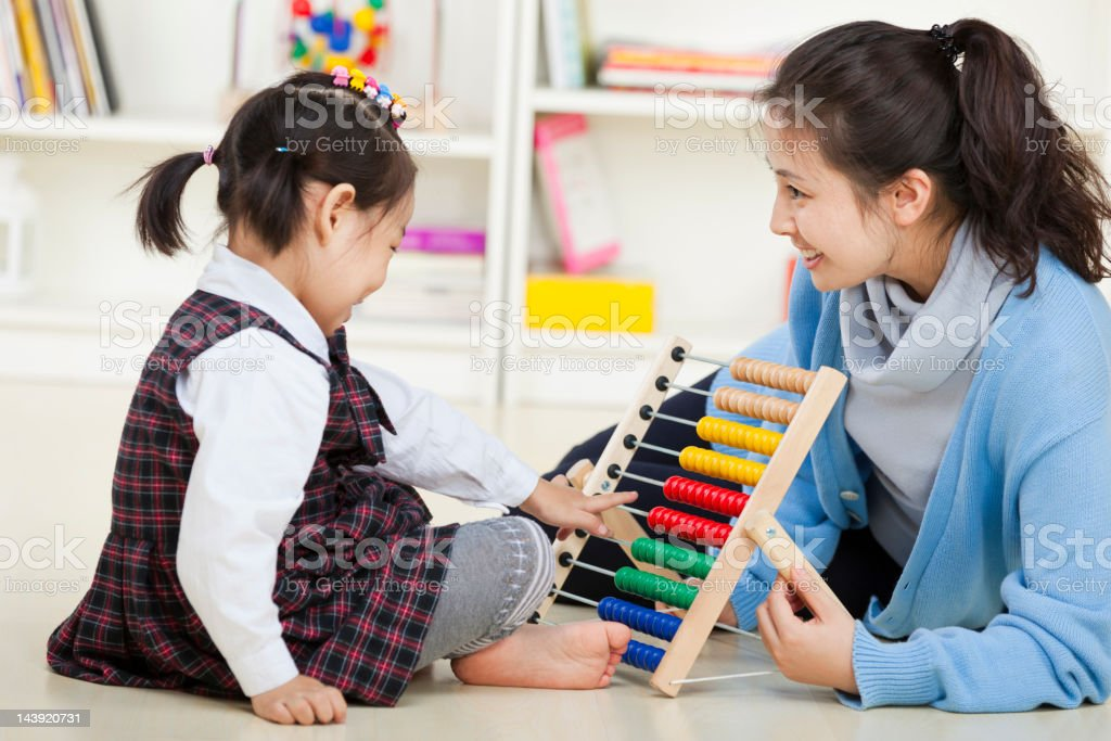 happy asian kid playing with teacher royalty-free stock photo