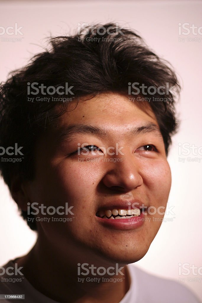Happy Asian Looking Up royalty-free stock photo