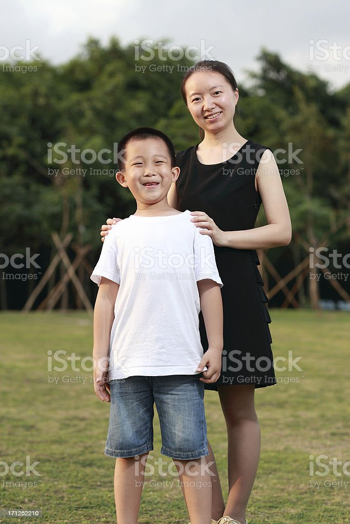 Happy Asian mother and son in sunlight royalty-free stock photo