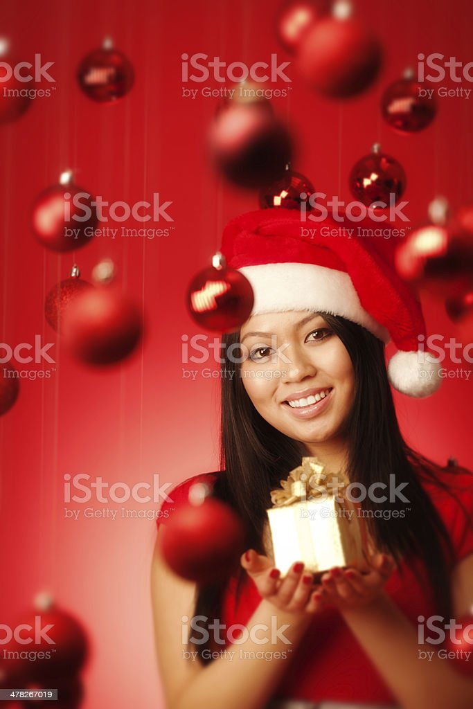 Happy Asian Santa Girl Holding Gift in Christmas Background Close-up royalty-free stock photo