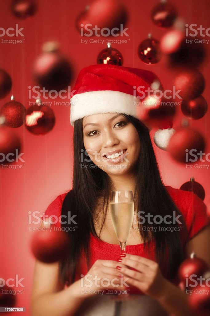 Happy Asian Santa Girl with Champagne in Christmas Background Vt royalty-free stock photo