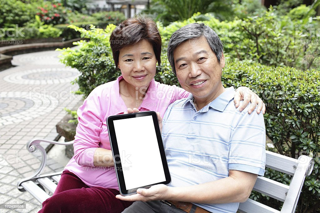 happy asian Senior couple showing tablet pc royalty-free stock photo