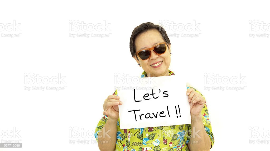 Happy Asian senior woman with let travel sign stock photo