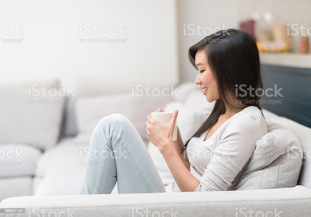 Happy Asian woman at home stock photo