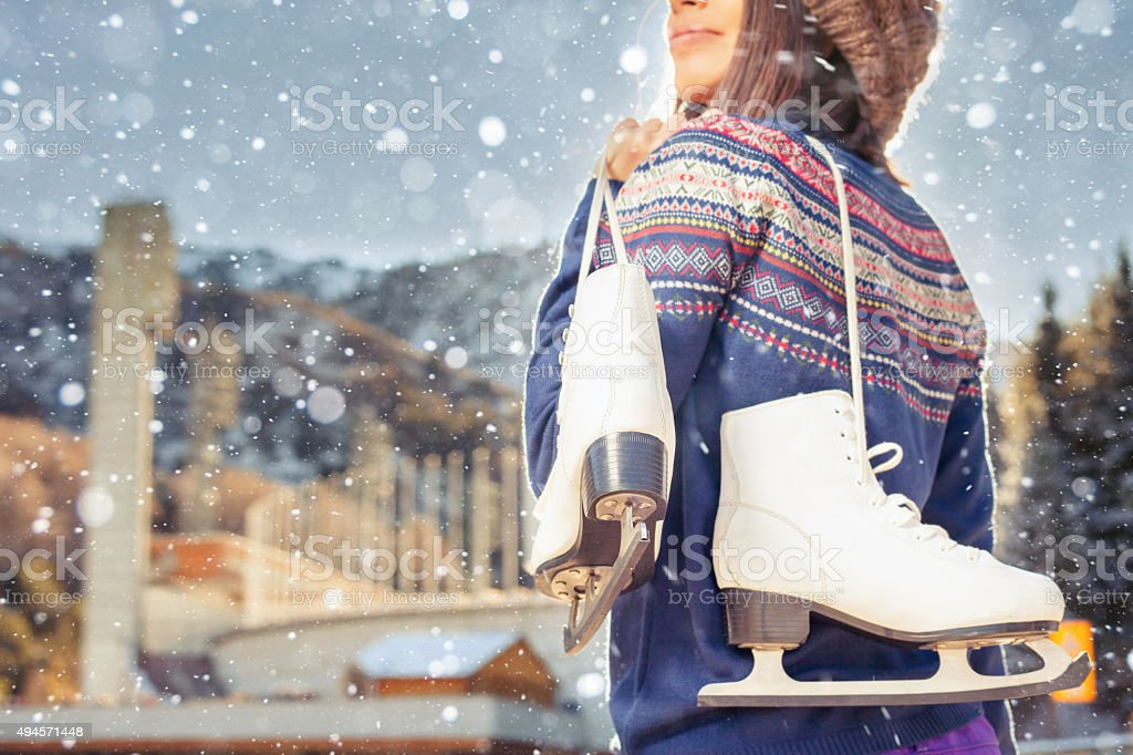 Happy asian woman going to ice skating outdoor stock photo