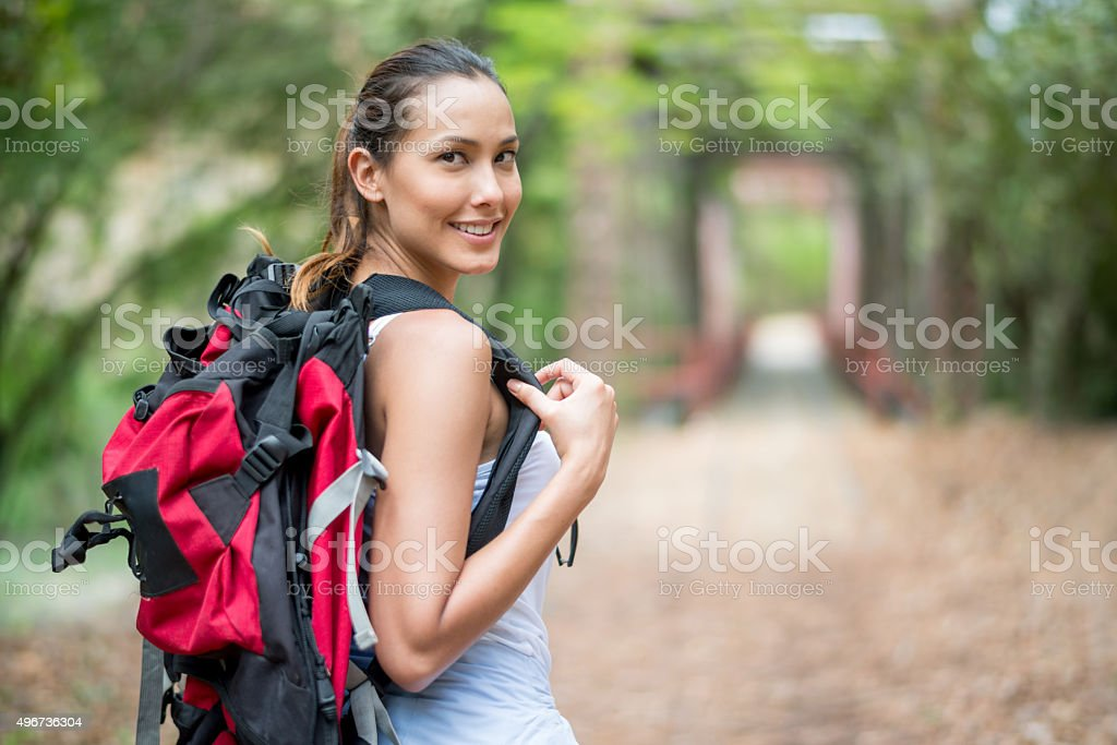 Happy Asian woman hiking stock photo