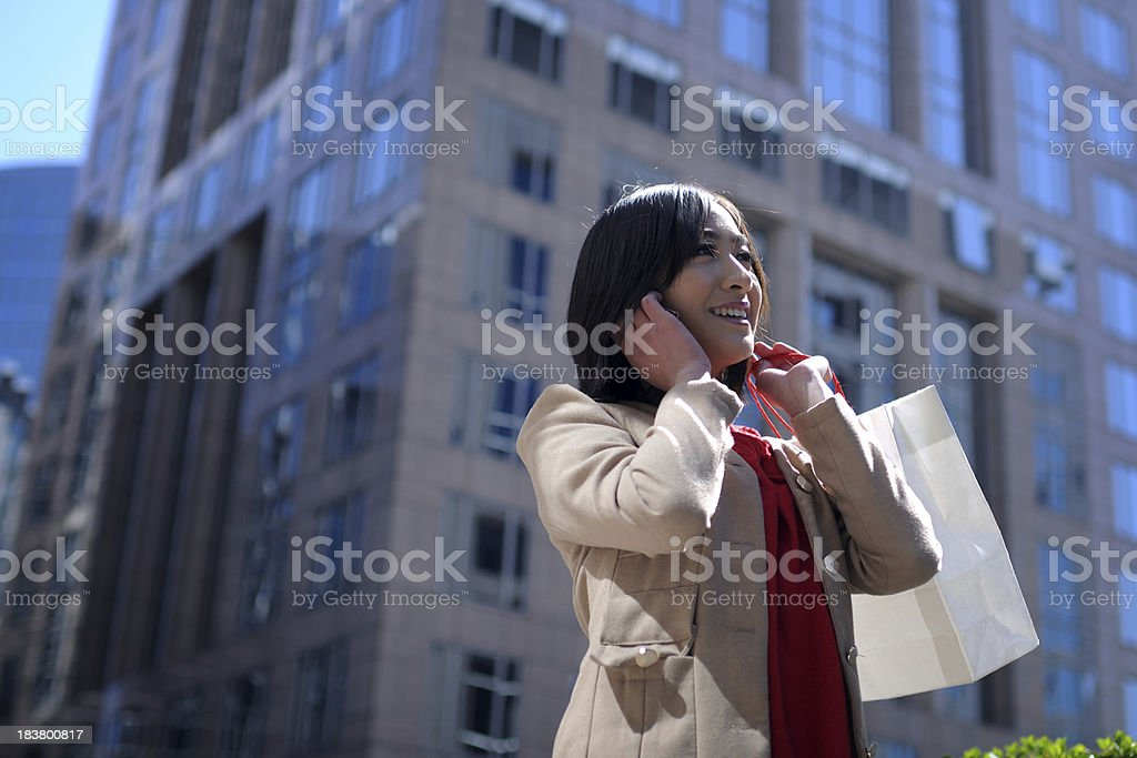 Happy Asian Woman On The Phone - XLarge royalty-free stock photo