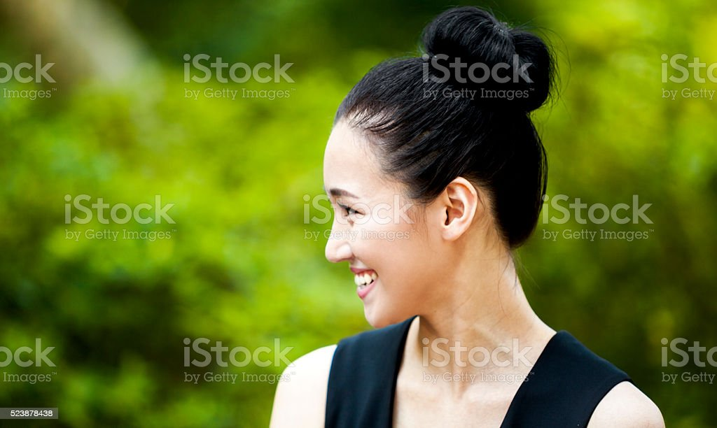 Happy Asian Woman Smiling in Nature stock photo