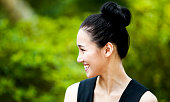 Happy Asian Woman Smiling in Nature