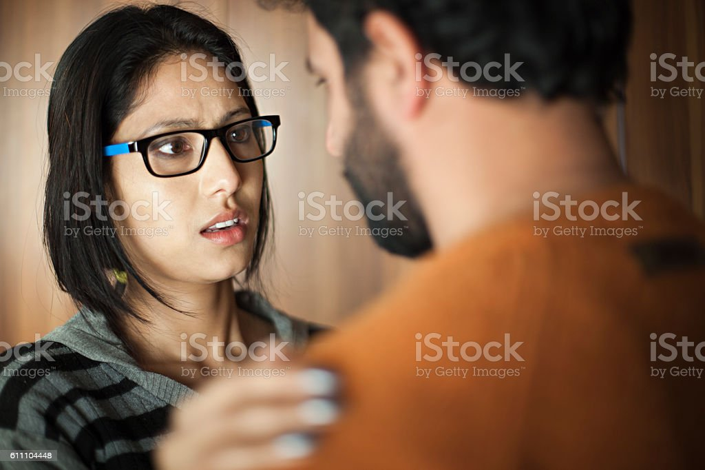 Happy Asian young man and woman talking face to face. stock photo