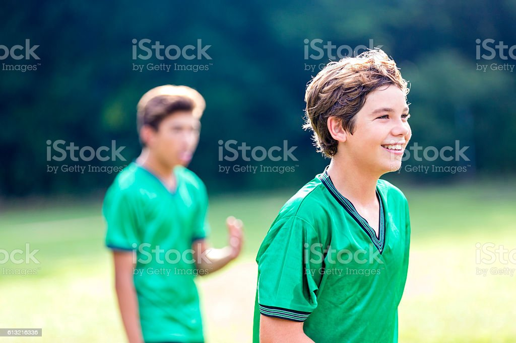 Happy athlete during soccer game stock photo