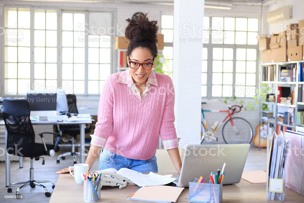 Happy attractive bussinesswoman at workplace stock photo