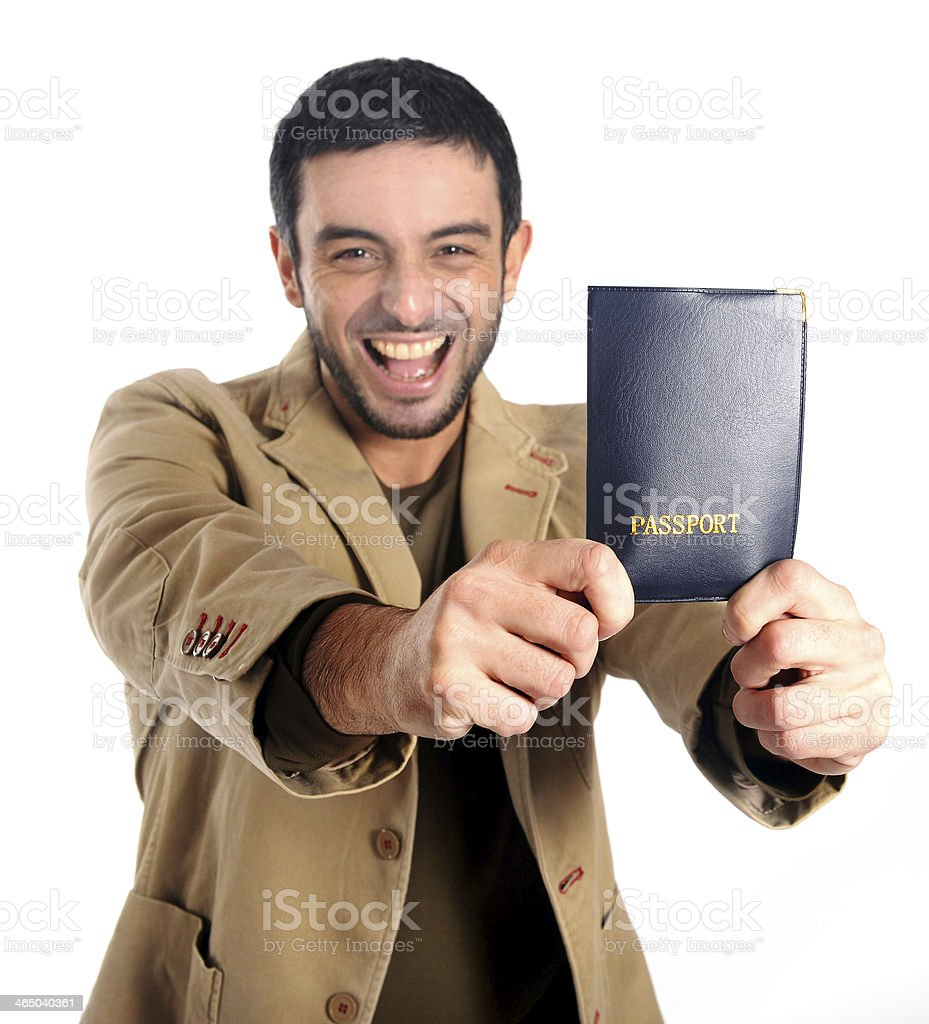 Happy Attractive man holding passport isolated white background royalty-free stock photo