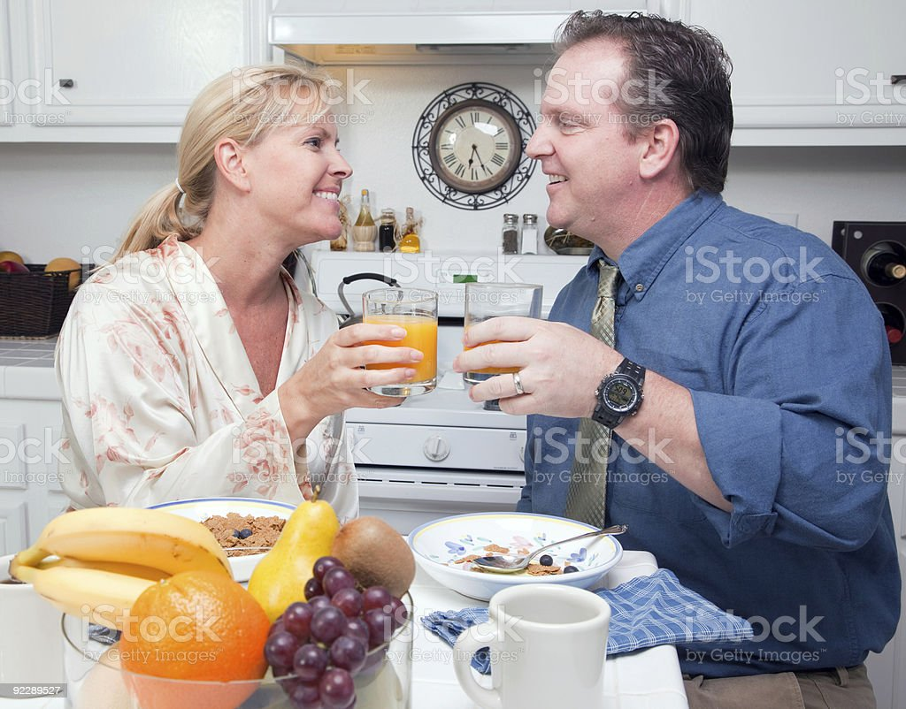 Happy Attractive Woman and Businessman In Kitchen royalty-free stock photo