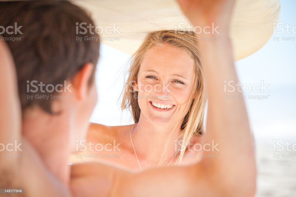 Happy attractive young Surfer Couple on the beach stock photo