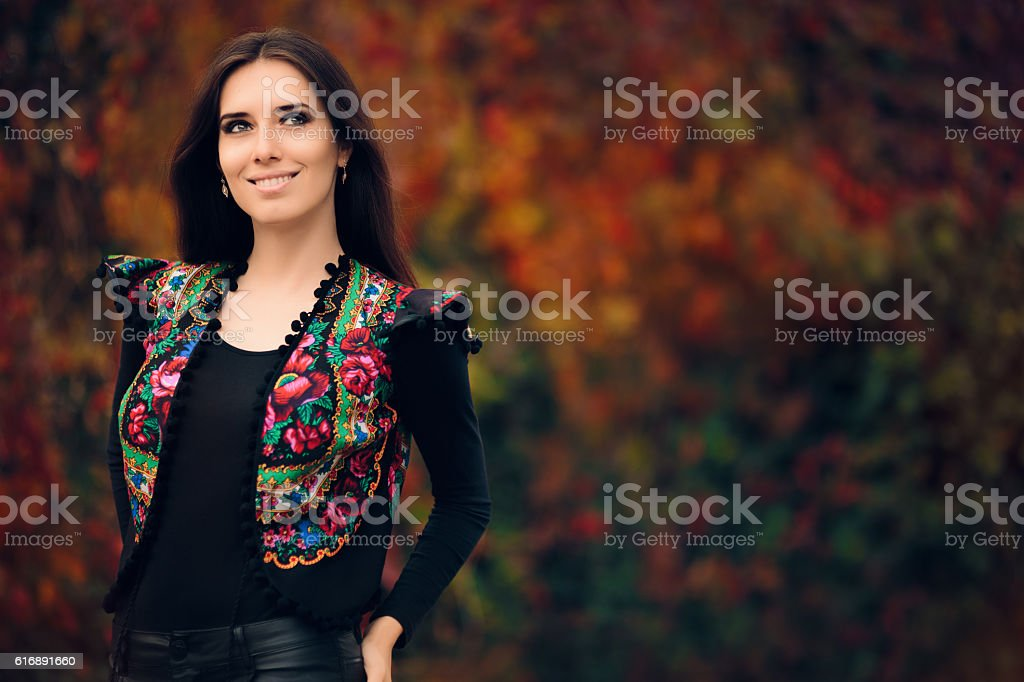 Happy Autumn Woman Wearing Colorful Ethnic Vest stock photo
