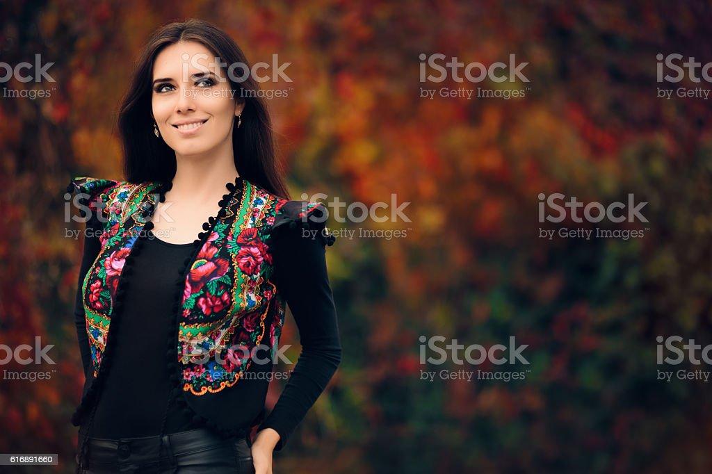 Happy Autumn Woman Wearing Colorful Ethnic Vest stock photo