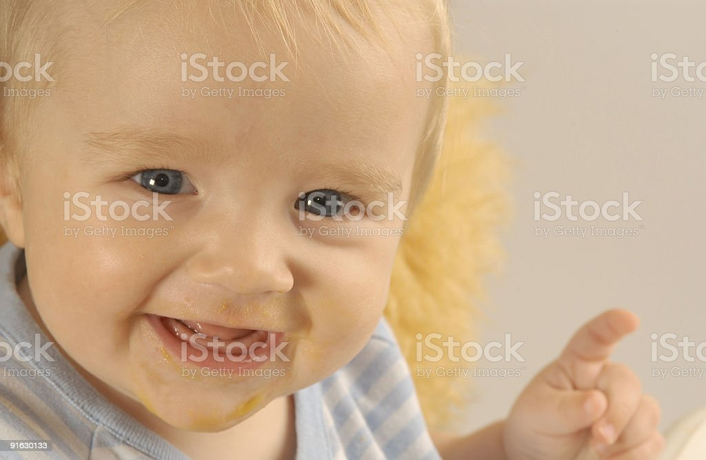 Happy baby boy after his dinner stock photo