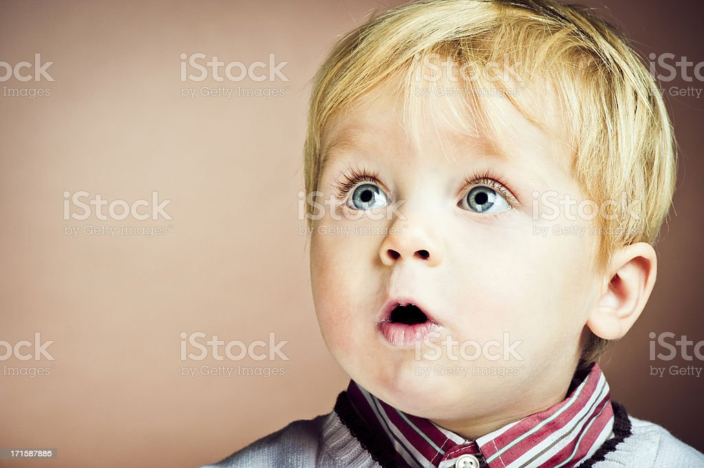 Happy baby boy in surprise royalty-free stock photo