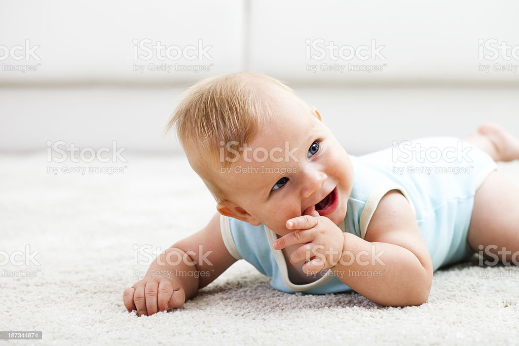 Happy baby boy on the white carpet royalty-free stock photo